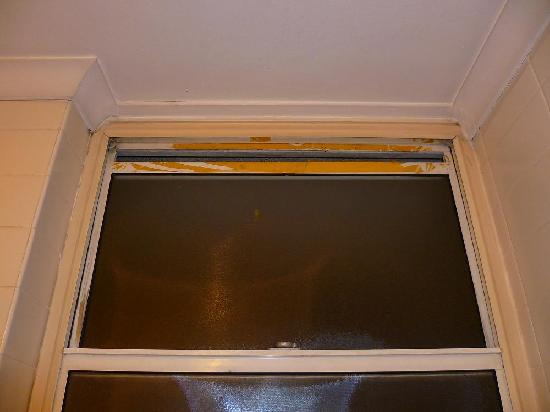 Carrington Apartments: bathroom window with sticky tape marks and a gap