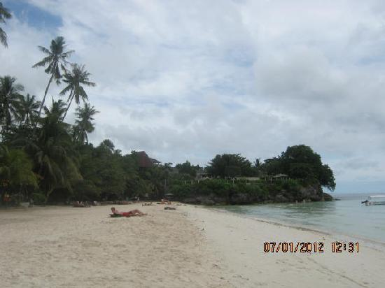 Cherrys @ Home Too Inland Resort: Alona Beach on the far end, on the other end you'll find the bars and restaurants