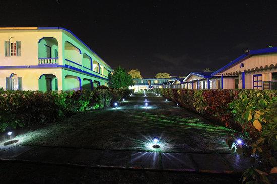 Travellers Beach Resort : Garden at night