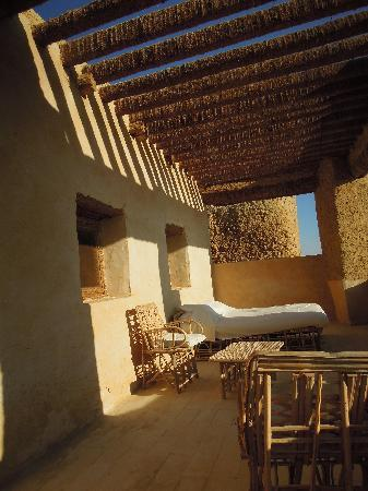 Adrere Amellal: Desert Ecolodge: Outdoor bed on the terrace (there is another bed inside!)