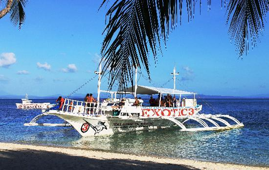 Malapascua Exotic Island Dive & Beach Resort: the beach and the boat