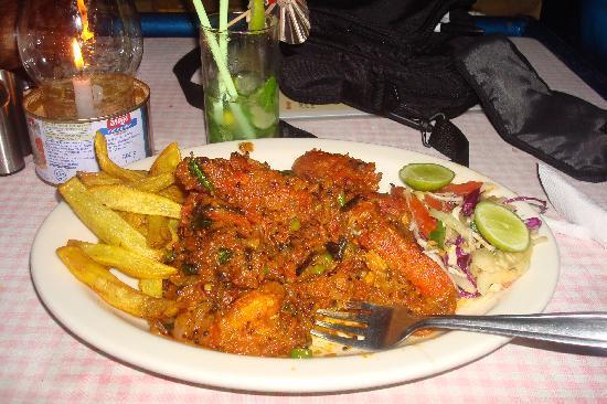 Sunrise : Wonderful tiger prawns masala with chips and salad