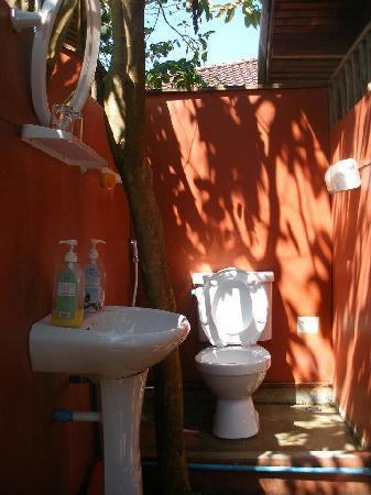 Fevrier Resort: Outdoor bathroom to wooden fan bungalow.