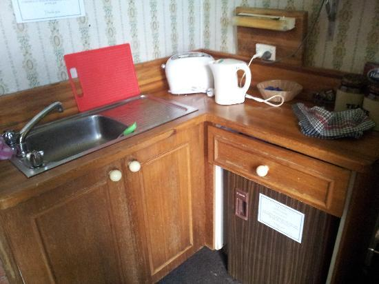 The Cecil Guesthouse: The Tea Room. My next door neighbors caravan has better condition than this