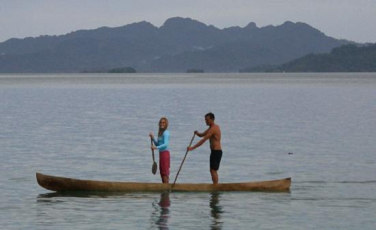 "Charapoana Island, หมู่เกาะโซโลมอน: ""duo stand up paddle"" with one of the local hand made wooden canoes."