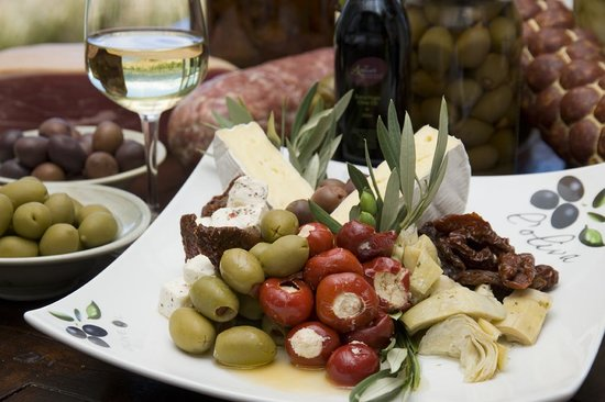 A Taste of Italy: Delectable individual antipasto platters served with a glass of wine