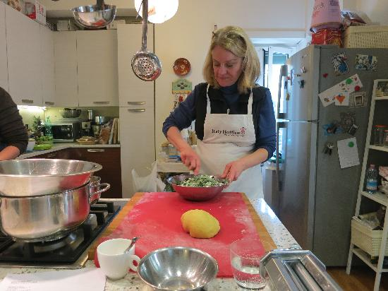 Italy Hotline Custom and Gourmet Tours: Mixing the filling for the pasta!