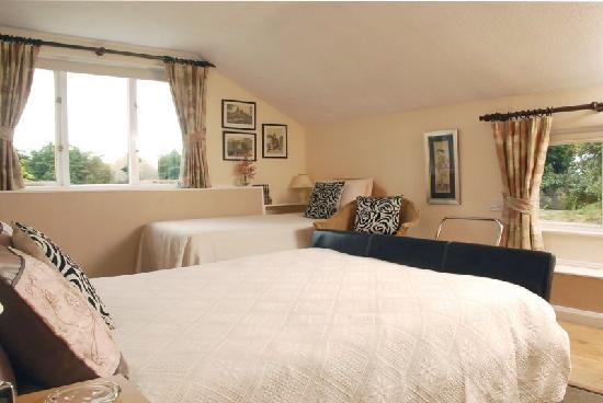 Beech Hill House: The spacious en-suite family room has dual aspect views overlooking the gardens.