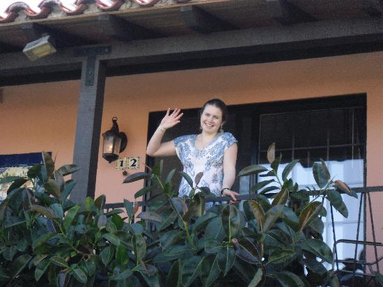 Hotel California: Liz waving near rubber tree