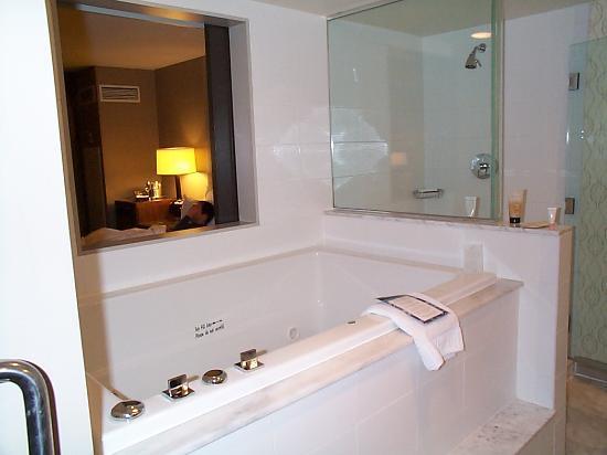 View From Bathroom Door Over Tub Through Window Into Bedroom