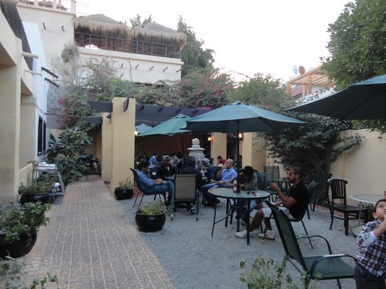 Coco's : the outside garden with tables