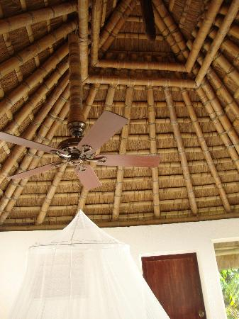 Puerto Del Sol Resort Hotel and Dive Center Coron: interior of roof with ceiling fan and mosquito net