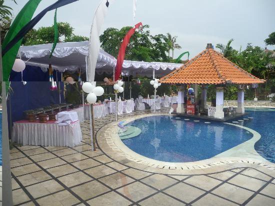 Puri Raja: Children's pool - Dining tables set up for New Years Eve