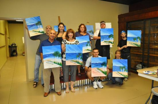 group picture at the end of class painting with a twist