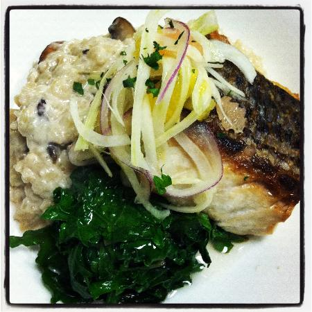 Heirloom Cafe: Wild striped bass with mushroom, risotto, kale, & citrus fennel slaw.