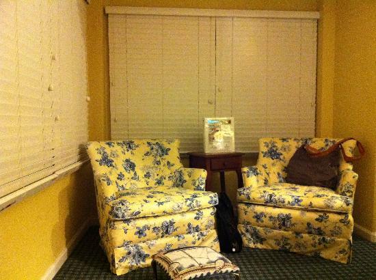 "Nature Coast Inn: sitting area of the ""Nautical"" room"