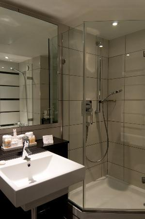 Club room features both a standalone shower cubicle and a shower in ...