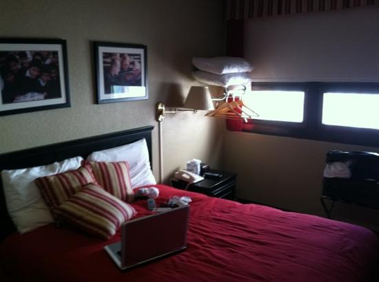 The Forum: twin bed and fold out windows