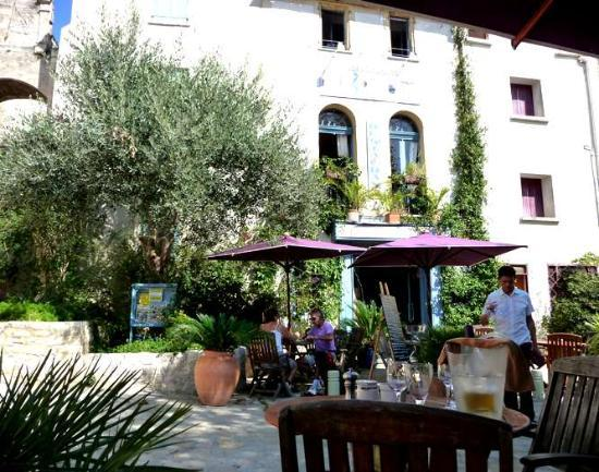 Chateau Haute-Fontaine : The square in Bages, ancient sundial (top left) and our favourite restaurant