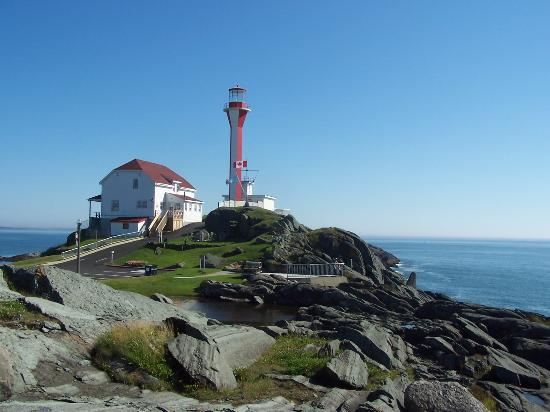 Cape Forchu Lightstation: view of lighthouse overlooking the ocean
