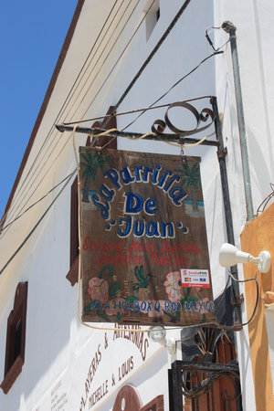 La Parrilla De Juan Holbox: The sign above the stairs to the restaurant.