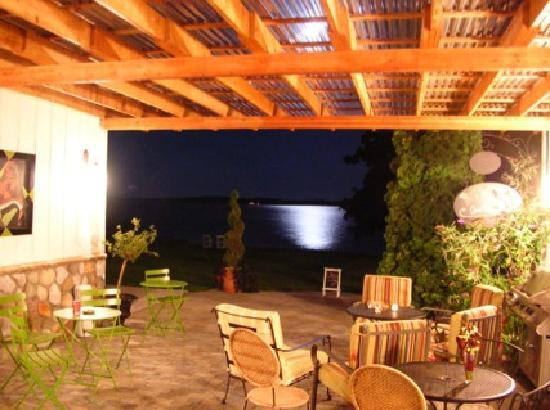 The Vineyard Inn: The pergola at night with the moon on the water