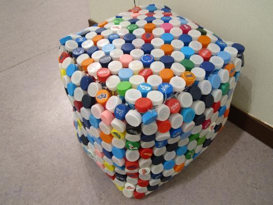 A Stool Made Of Bottle Caps And Plastic Trash Picture