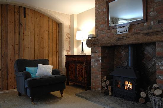 The Coach House: Cosy armchair and wood burning stove