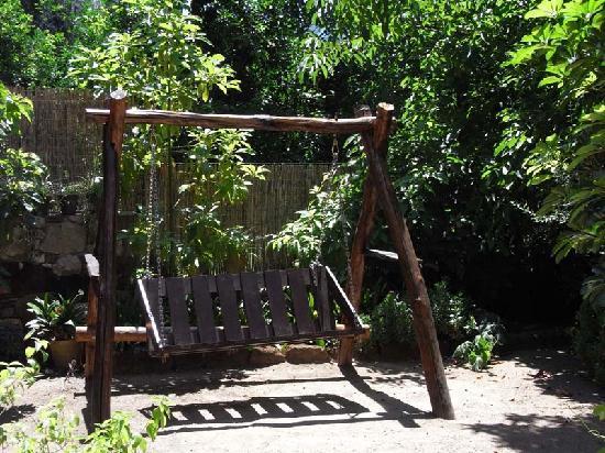 Swinging sofa in the garden.