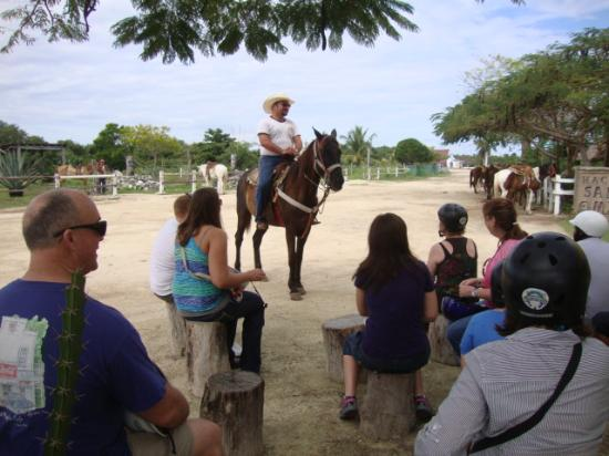Rancho Buenavista: Clinton is giving lessons on how to handle a horse