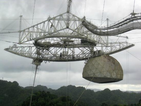Arecibo Observatory: Reflectors and antennae suspended above the valley