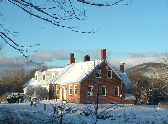 Olde Orchard Farm: under a cosy blanket of snow... notice the seven chimneys!