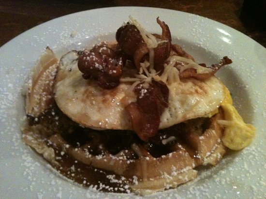 Aurants : southwest chicken & waffles w/ ancho chili maple syrup, smoked Gouda, crispy bacon.