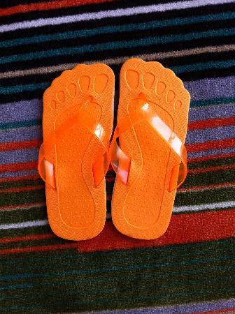 HARRIS Suites FX Sudirman: Orange Room Slipper
