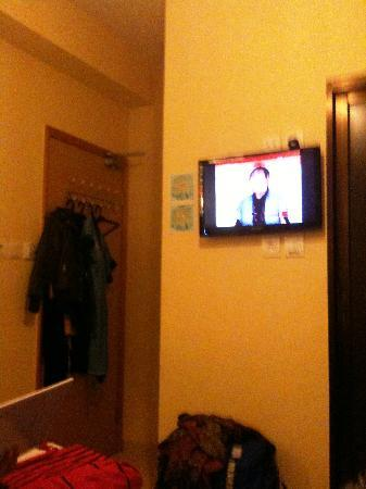 Golden Crown Guesthouse: door and  flat TV w/ only 1 English channel
