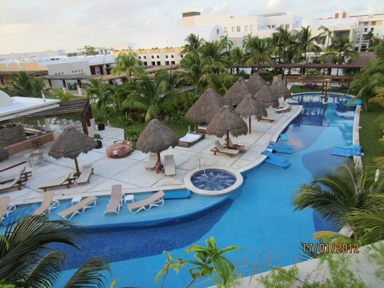 Excellence Playa Mujeres: Main pool with Lobster and Grill restaurants