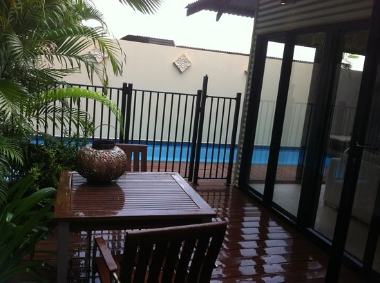 The Pearle of Cable Beach: rear area with table and pool plus sun lounges