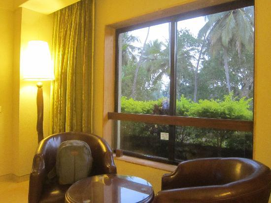 Neelam Hotels - The Glitz Goa: Glowing Lamp & Sitting Area besides the window