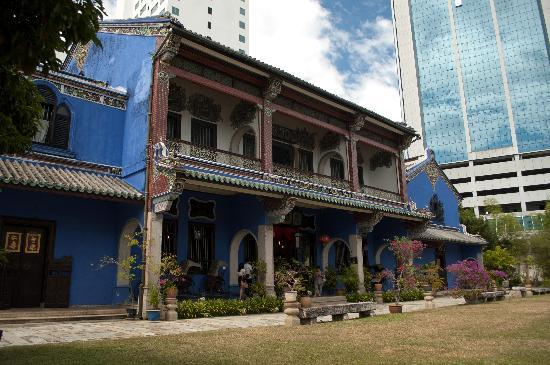 Cheong Fatt Tze - The Blue Mansion: The Blue Mansion offset against the nearby tower block - but the surrounding area still has a re
