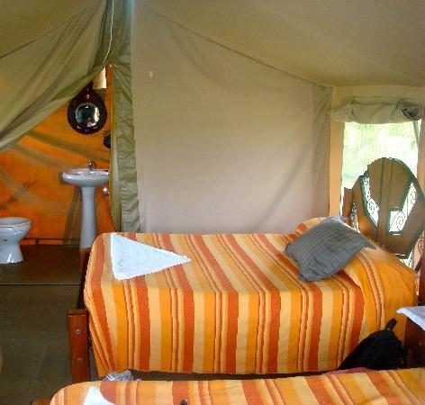 Elangata Olerai Luxury Tented Camp: Another picture of the inside of the tent, in the far back--toilet and shower