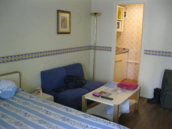 Aparthotel Tribunal: camera e cucina
