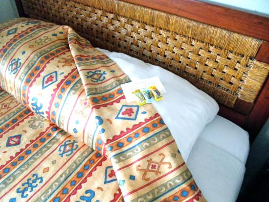 Hotel la Siesta: the welcoming bed awaits, with treats on pillow