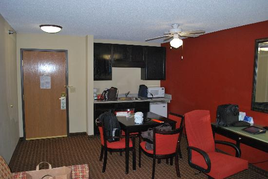 Holiday Inn Hotel & Suites Owatonna: Looking back at sitting area and kitchenette.