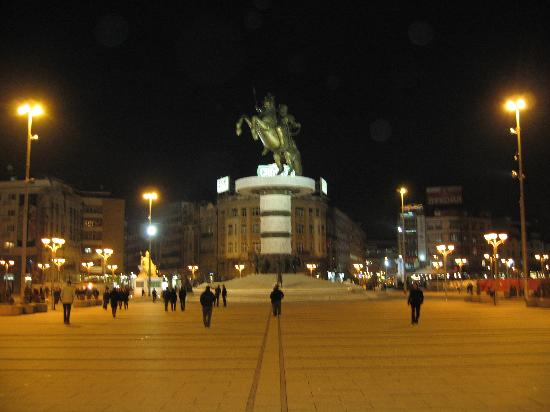 Warrior on a Horse: Square with statue in the evening