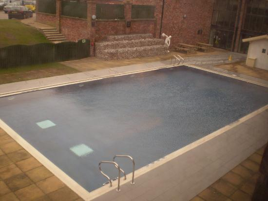 Indoor swimming pool picture of village hotel blackpool for Heated garden swimming pools