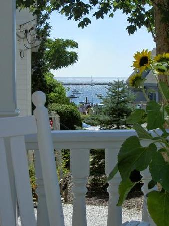 White Porch Inn: Take in a glimpse of the bay from the porch of our Provincetown B&B