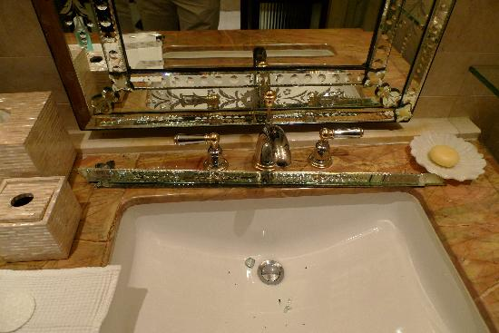 The Leela Palace Udaipur: Part of a mirror fell of the bathroom wall leaving glass in the basin and on the floor; not a wo