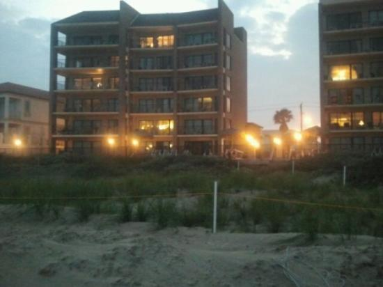 Evening view of SeaBreeze Beach Resort while standing at water's edge