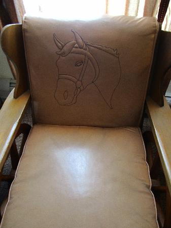 The Leland House and Rochester Hotel: Cute chair with horse detail