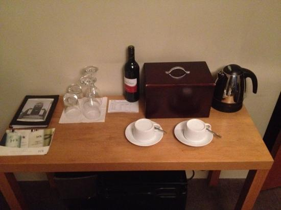 Amherst Brighton: Side table with 'goodie' box and glasses.